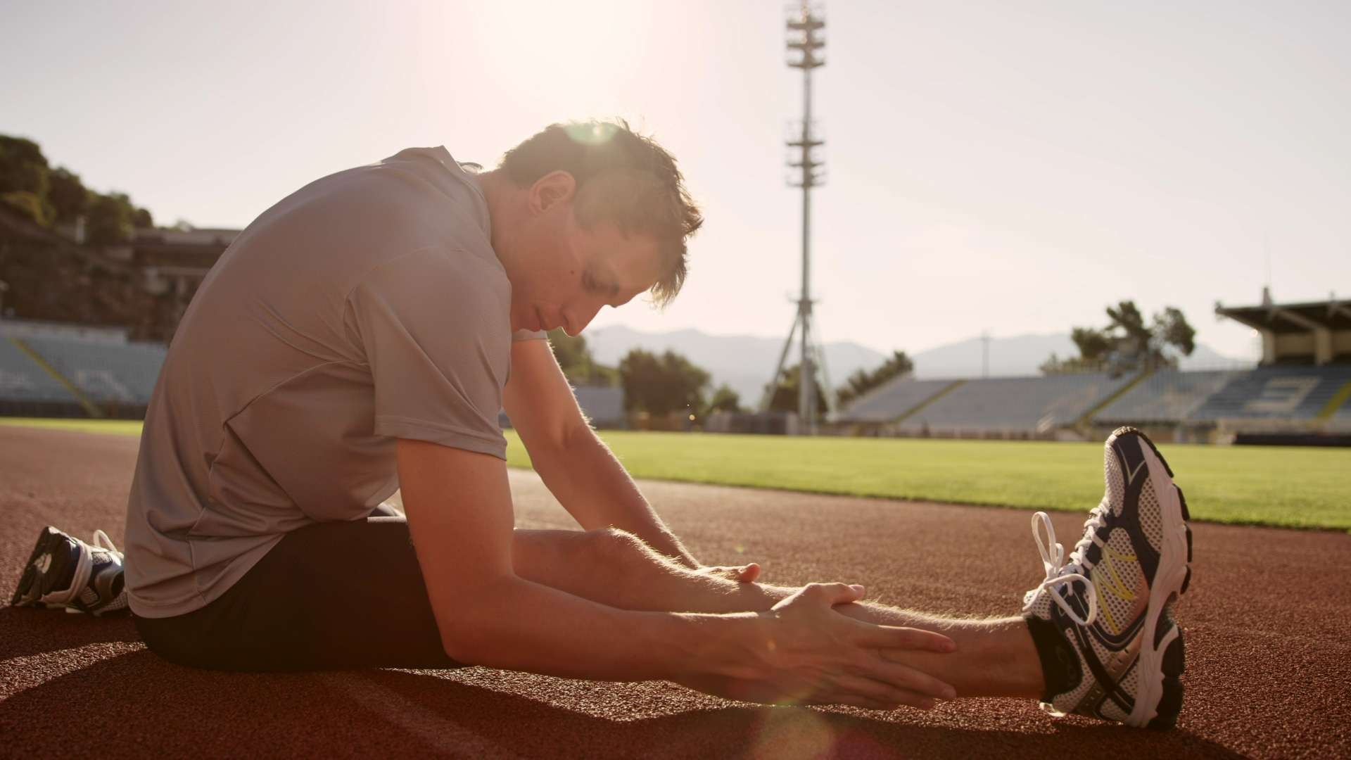 prodiet fluid - male runner stretching on a track